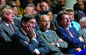 Bob Greifeld (L), CEO of NASDAQ, Paul Calello (C), CEO of Credit Suisse and Bob Diamond (R), President of Barclays, listen to a speech by US President Barack Obama about reforming Wall Street and the financial reform bill in the Great Hall at Cooper Union in New York, April 22, 2010. AFP PHOTO / Saul LOEB (Photo credit should read SAUL LOEB/AFP/Getty Images)