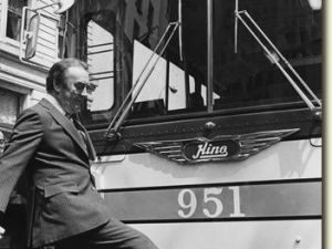 Governor Hugh Carey pictured with one of the new Hino buses in New York City, kicking the bus for emphasis. A number of buses were bought in 1981 to ease the strain on New York City's public transit. (via NYS archives. photographer not identified)
