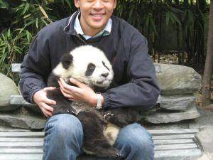 Mr. Guo with baby panda