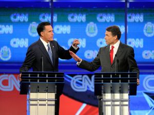 Rick Perry and Mitt Romney squared off on stage at the Sands Expo Center in Vegas. (Getty)