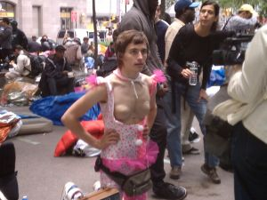 A young man being interviewed at Occupy Wall Street.