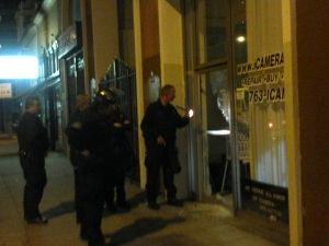 Police investigate the camera store nearby Occupy Oakland. (Hunter Walker)