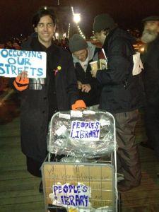 The Occupy Wall Street library crossing the Brooklyn Bridge last night.