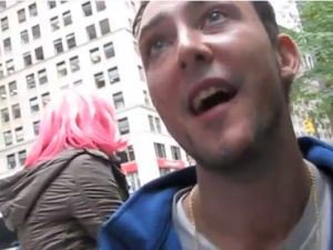 """Danny """"Lotion Man"""" Cline occupying Wall Street. (Photo: YouTube.com/AmazingStrangersNYC)"""