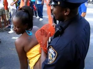 NYPD officer at West Indian Day parade (YouTube)