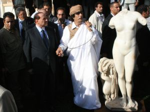 Gaddafi and Mr. Berlusconi admiring a headless statue of Venus in 2008. (Mahmud Turkia/AFP/Getty)