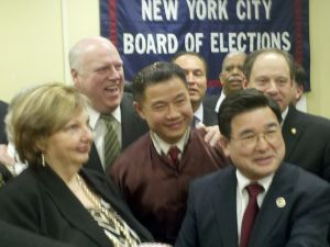 Peter Koo was surrounded by a throng of Democrats as he announced his party switch.