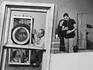 Billy Klüver and Robert Rauschenberg working in Rauschenberg's studio in late 1964 or early 1965. (Rauschenberg Foundation)