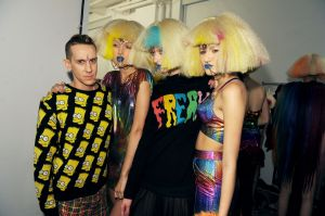 Jeremy Scott with candy colored clown models (Getty)