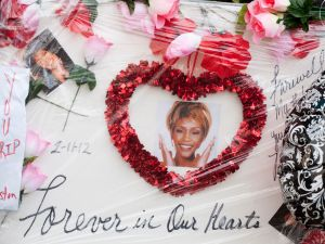 Fan messages for Whitney Houston outside New Jersey church (Getty Images)
