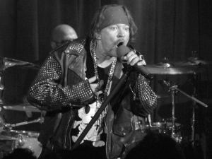 Handlebar and all, Axl Rose preaches the rock gospel. (Paul Bruinooge/ PatrickMcMullan)