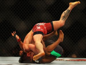 MMA fighters duking it out at a recent UFC bout in Australia. (Photo: Getty)