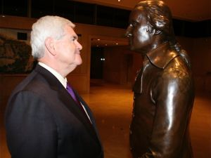 "Newt staring down a bronze statue of George Washington at the 2010 premiere of his documentary about Pope John Paul II ""Nine Days That Shook The World."" (Photo: Facebook)"