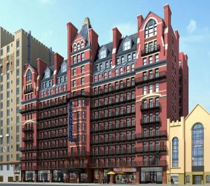 A rendering of the renovated hotel, with new windows and a penthouse. (Real Deal)