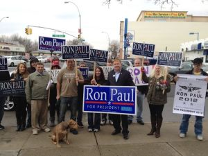 "Dan Halloran holding a ""Ron Paul for President"" sign. (Photo: Facebook)"
