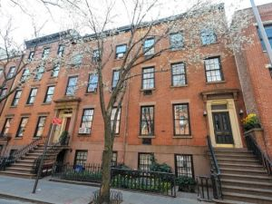 Oh, please, honey. I don't want one townhouse, I want TWO. (Courtesy Daily News)