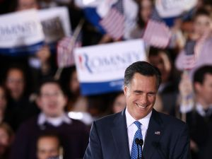 Mitt Romney celebrating his victories last night. (Photo: Getty)
