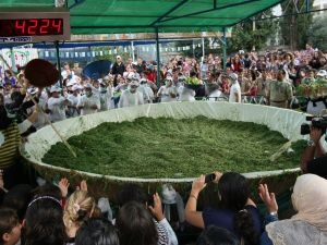This 2009 photo shows people in Shfaram, Israel, making what was then the largest Tabouleh salad ever created. (Courtesy Jack Guez/AFP/Getty)