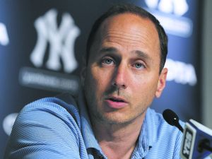 Yankees General Manager Brian Cashman is in trouble for conspiring to have his girlfriend committed.. (Jim McIsaac/Getty Images)