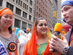 Grace Meng, left, being interviewed on Punjabi television. (Photo: Meng campaign)