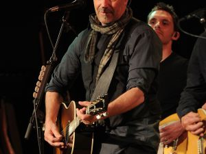 Kevin Costner plays the guitar. (Courtesy Getty Images)