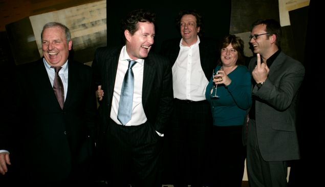 Mr. Coulson, far right, flips the bird at Piers Morgan's book party in 2005.