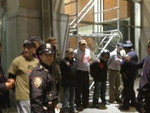 Arrested protesters lined up inside Vietnam Veterans Plaza. (Photo: Hunter Walker)