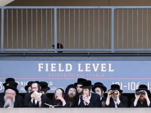 Ultra-Orthodox Jews take in the view from Citi Field at a meeting to discuss the risks of using the Internet on May 20, 2012. (Photo by Mario Tama/Getty Images)