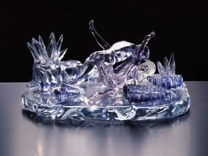 "Jeff Koons, "" Violet-Ice (Kama Sutra),"" 1991. Colored Murano glass, 13 x 27 1/4 x 16 1/2 in. (Courtesy Venus Over Manhattan)"