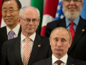 Vladimir Putin striking a pose with the other world leaders at the G20 Summit. (Photo: Getty)