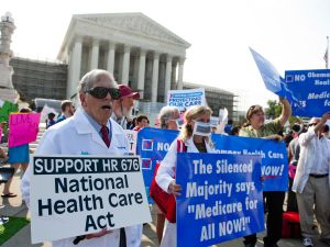 Demonstrators protesting on the Supreme Court steps in advance of the decision on the healthcare law. (Photo: Getty)
