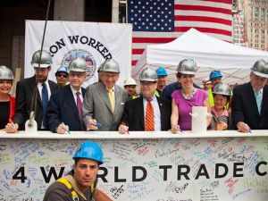 Larry Silverstein and a coterie of elected officials sign the final column. (Joe Woolhead/Silverstein Properties)