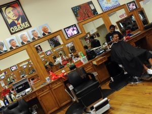 Photos of President Obama hanging in an LA barbershop in 2009. (Photo: Getty)