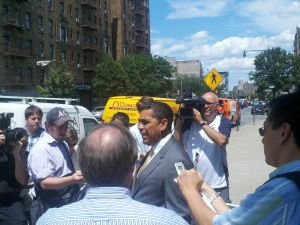 Espaillat giving his concession speech to a crowd of reporters.