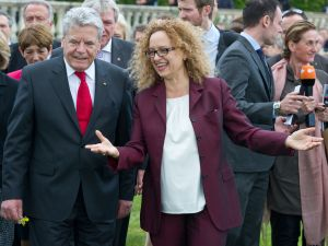 German President Joachim Gauck speaks with the artistic director of documenta Carolyn Christov-Bakargiev at the opening of the exhibition, June 9, 2012. (Courtesy Boris Roessler/AFP/Getty Images)
