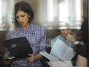 Alyokhina and Samutsevich in court on July 30. (Courtesy Andrey Smirnov/AFP/Getty Images)