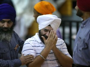 A mourner crying at a service in Oak Creek Friday for the victims of the Sikh Temple shooting. (Photo: Getty)
