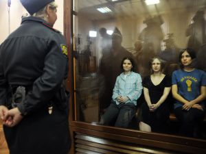 Members of Pussy Riot Nadezhda Tolokonnikova, Maria Alyokhina and Yekaterina Samutsevich during a court hearing in Moscow today. (Photo by Andrey Smirnov/AFP/GettyImages)