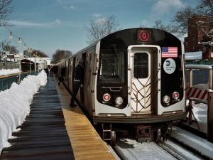 Neither rain nor snow nor dark of night will keep the Q-train from its appointed rounds. (gmpicket/Flickr)