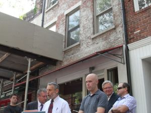 Steve Ashkinazy of the Stonewall Democratic Club of New York City discusses the house's history at a press conference today. (Greenwich Village Society for Historic Preservation)