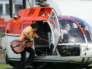 Karl Huros jumping in a helicopter on June 17, 2007, to perform the quartet. (Courtesy Stefan Simonsen/AFP/Getty Images)