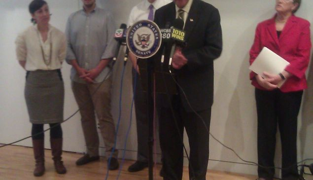 Senator Schumer, with David Tisch and Jessica Lawrence at his side.