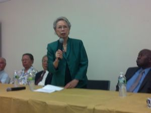 Virginia Kee speaking next to former Rep. Major Owens