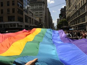 Marchers carry a rainbow flag down 5th Avenue during the 2012 New York Gay Pride parade. (Photo credit: TIMOTHY A. CLARY/AFP/Getty Images)