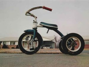 William Eggleston, 'Memphis (Tricycle),' c. 1970, dye-transfer print, printed 1980. Signed, date, number '13/20' in pencil and copyright credit reproduction limitation stamp (on the verso). Image: 12 x 17½ inches. (Courtesy artnet.com)