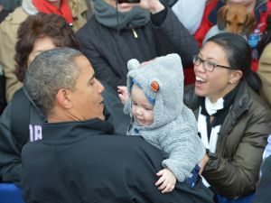 President Obama holding a baby at a rally in Colorado earlier this month. (Photo: Getty)