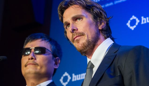 Guangcheng and Bale. (Michael Stewart/Getty Images)