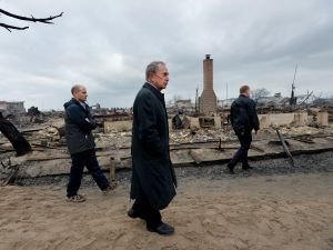 Mayor Bloomberg tours the damage in Breezy Point. (Photo: Getty)