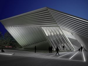 Eli and Edythe Broad Museum. View of the west facade and plaza at night. (Courtesy of Zaha Hadid Architects).