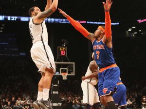 Deron Williams getting a shot past Carmelo Anthony during the Nets' win over the Knicks Monday night. (Photo: Getty)